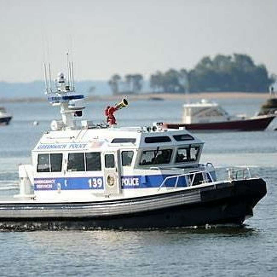 Greenwich police patrol Greenwich waters. Marine officers saved a man whose boat sank off Old Greenwich Monday. Photo: /