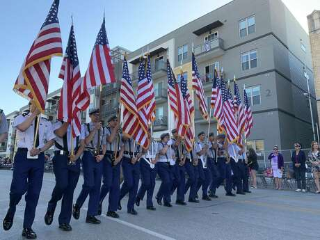 The Vanguard is on its way at 9 a.m. during the Battle of Flowers Parade along Broadway on Friday, April 26, 2019.