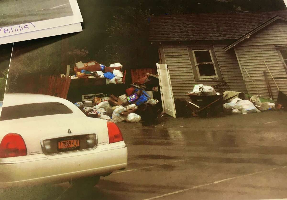 A photo taken of the Crest Inn Suites and Cottages in either 2015 or 2016 that was included in the town of Wilton's code enforcement files on the motel. The photo shows overflowing garbage as well as a limo parked at the property. The town cited Shahed Hussain for years over the garbage and parking his limousines at the motel in violation of town code.