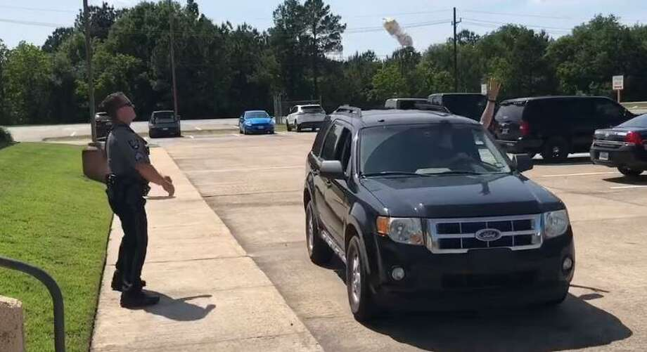 A Facebook video produced by the Montgomery County Precinct 4 Constable's Office shows Lt. Jim Slack demonstrating pick-upduring National Prescription Drug Take Back Day. Photo: Courtesy Of The Montgomery County Precinct 4 Constable's Office