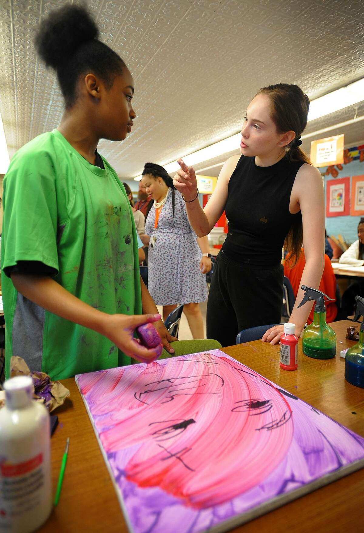 Turnaround Arts program artist Autumn DeForest, of Las Vegas, Nevada, helps 6th grader Chelsea McLaren, 12, make a self portrait during a visit to Hallen School in Bridgeport, Conn. on Tuesday, June 12, 2018.