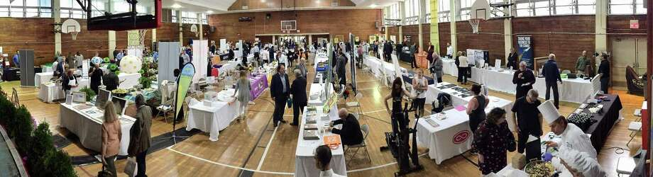 The Greenwich Chamber of Commerce holds its annual Business Showcase, a tabletop exhibition, at Eastern Greenwich Civic Center in Old Greenwich April 25, 2019. Over 400 guests viewed information from 74 diverse businesses while enjoying food and raffles at the biggest networking event of the year. Photo: Matthew Brown / Hearst Connecticut Media / Stamford Advocate