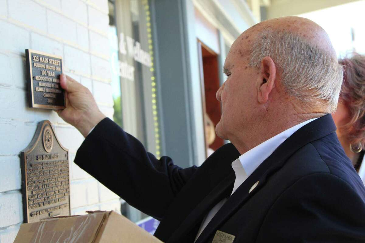 City of Humble Mayor Merle Aaron places a commemorative plaque on the Abundant Health and Wellness Center on April 25, 2019.