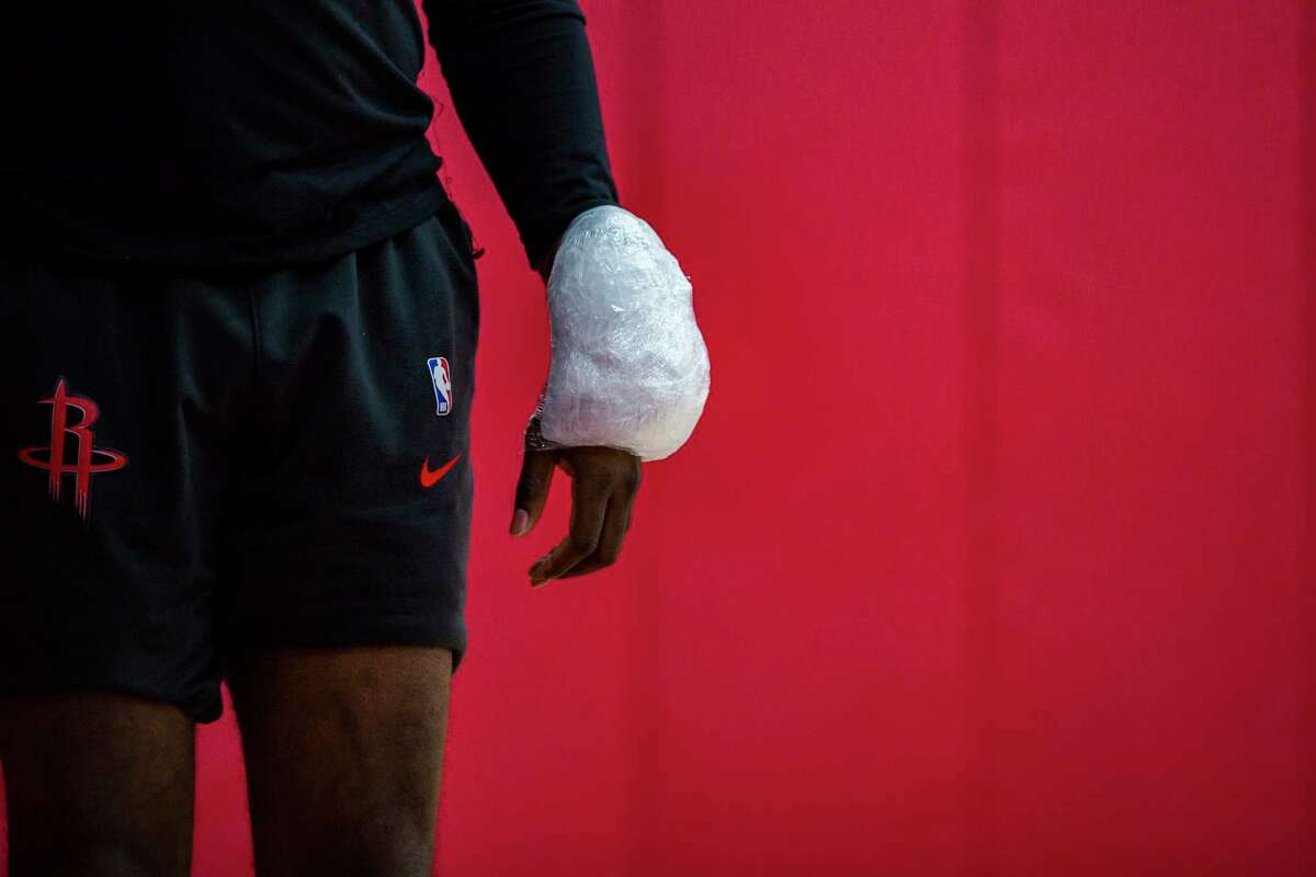Rockets guard James Harden shows up to a team practice with ice wrapped around his wrist at the Toyota Center on Friday, April 26, 2019, in Houston.
