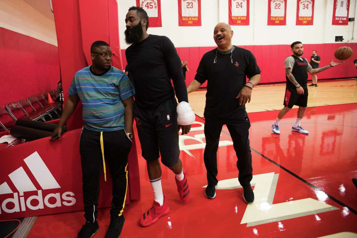 Rockets guard James Harden walks toward the members of the media to answer questions with ice wrapped around his wrist before a team practice at the Toyota Center on Friday, April 26, 2019, in Houston.