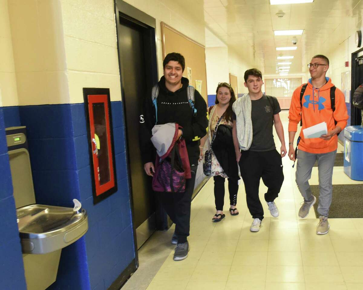 From left, P-Tech students Owais Husain, Monique Beam, Nick Brasmeister and Marcos Santiago from the Hamilton Fulton Montgomery BOCES program walk to class at Fulton Montgomery Community College on Thursday, April 25, 2019 in Johnstown, N.Y. (Lori Van Buren/Times Union)