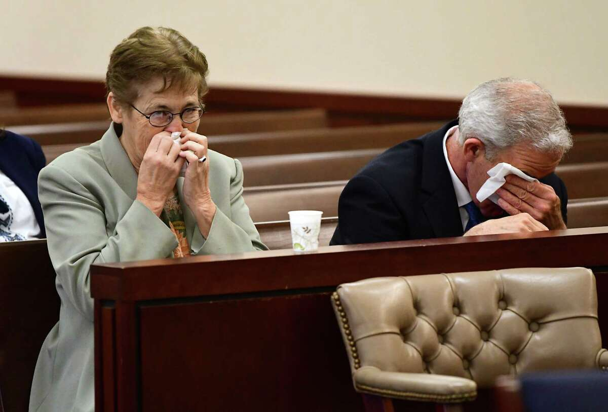 Peg and Mick Richards wipe their tears away as they listen to final remarks from Assistant Attorney Blain Lewis at the sentencing of Tamale Harris at Albany County Court on Friday, April 26, 2019 in Albany, N.Y. Harris was sentenced 9 1/2 to 19 years for ignoring their daughter Keisha Richards as she overdosed on heroin and then dumping her body in a snowbank on Kent Street in Albany. (Lori Van Buren/Times Union)