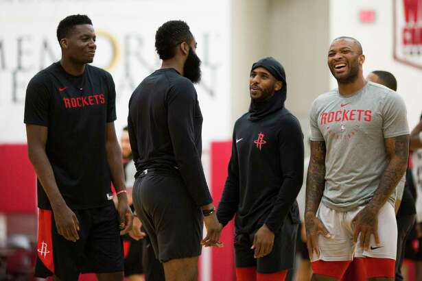 Rockets Clint Capela, James Harden Chris Paul and PJ Tucker share a moment during a team practice at the Toyota Center on Friday, April 26, 2019, in Houston.