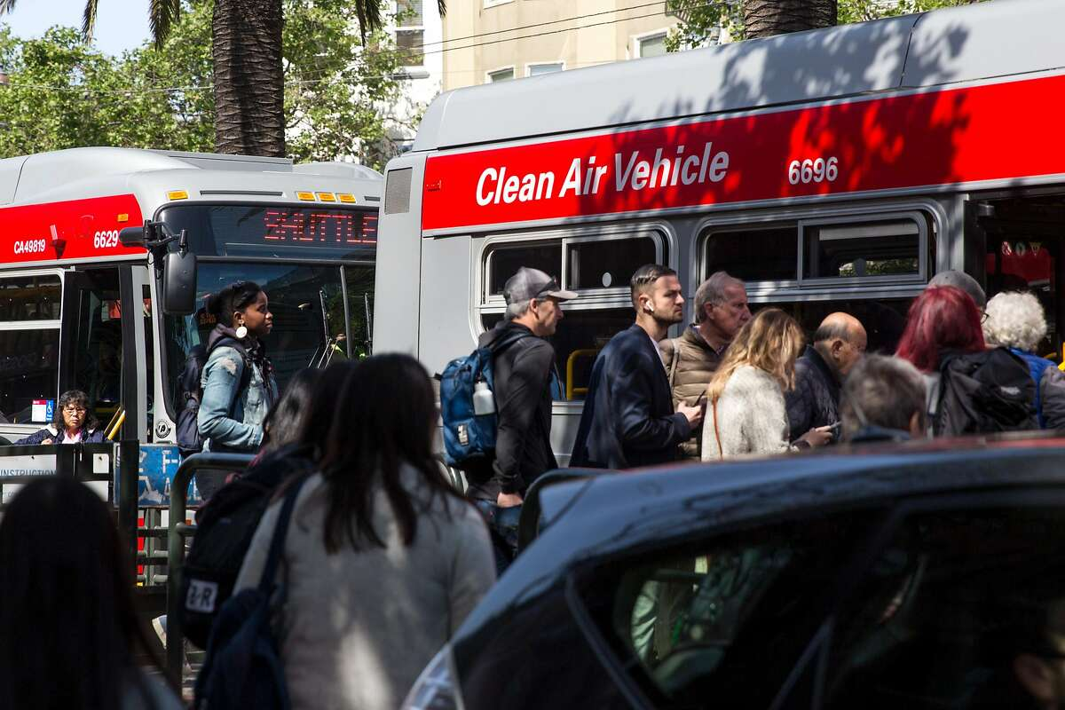People board shuttle buses at Market and Church Street headed downtown. After a power line failure commuters had to take alternative route to get to their destinations. On Friday, April 26, 2019. San Francisco, Calif.