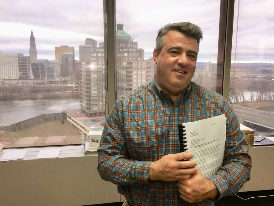 John DiIorio, founder and CEO of 1st Alliance Lending in East Hartford, in his office overlooking downtown Hartford. The company has gone out of business and vacated the space. Photo: Hearst Connecticut Media File Photo