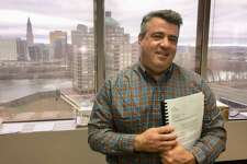 John DiIorio, founder and CEO of 1st Alliance Lending in East Hartford, in his office overlooking downtown Hartford. He is fighting an effort by the state to shut down his company for mortgage loan activity he says is legal.