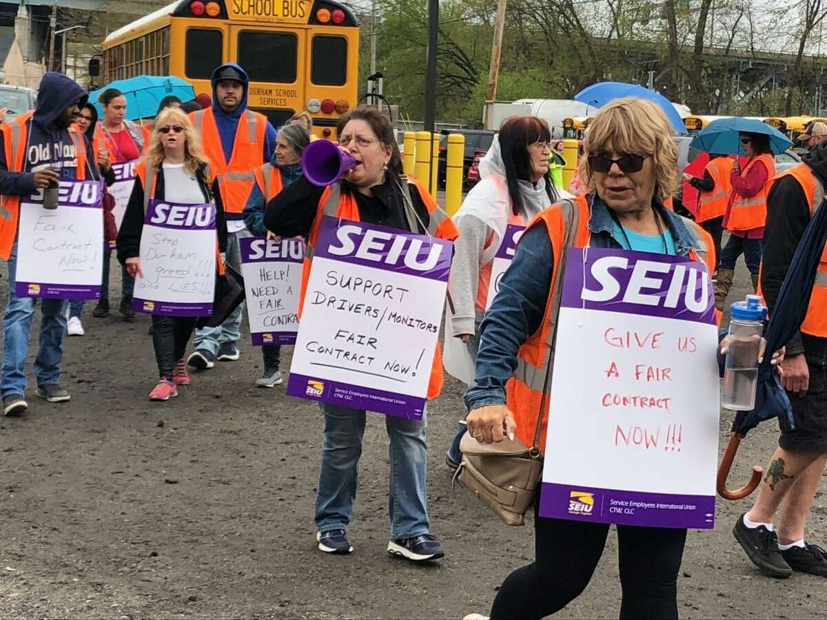 Shelton bus drivers and monitors chanted slogans and held signs the morning of Friday, April 26, picketing at the bus maintenance garage on Riverdale Avenue.