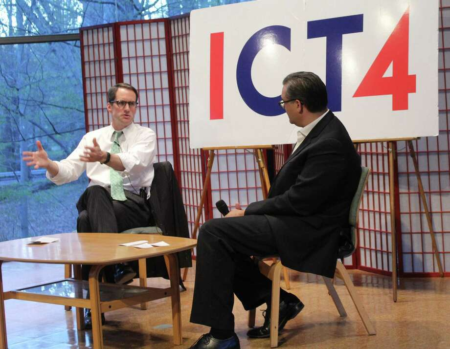 U.S. Rep. Jim Himes spoke with Eric Screwvala at a town hall event on April 24 at The Unitarian Church in Westport. Photo: Sophie Vaughan / Hearst Connecticut Media / Westport News