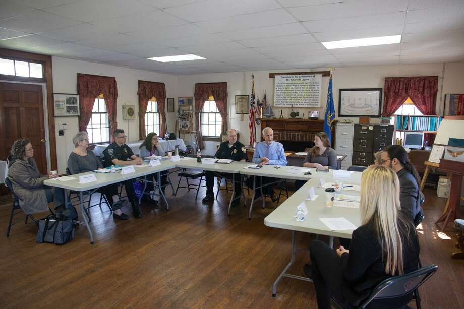 State Sen. Norm Needleman, center, leads a roundtable discussion on responses to the opioid crisis Thursday in East Hampton. Photo: Contributed Photo