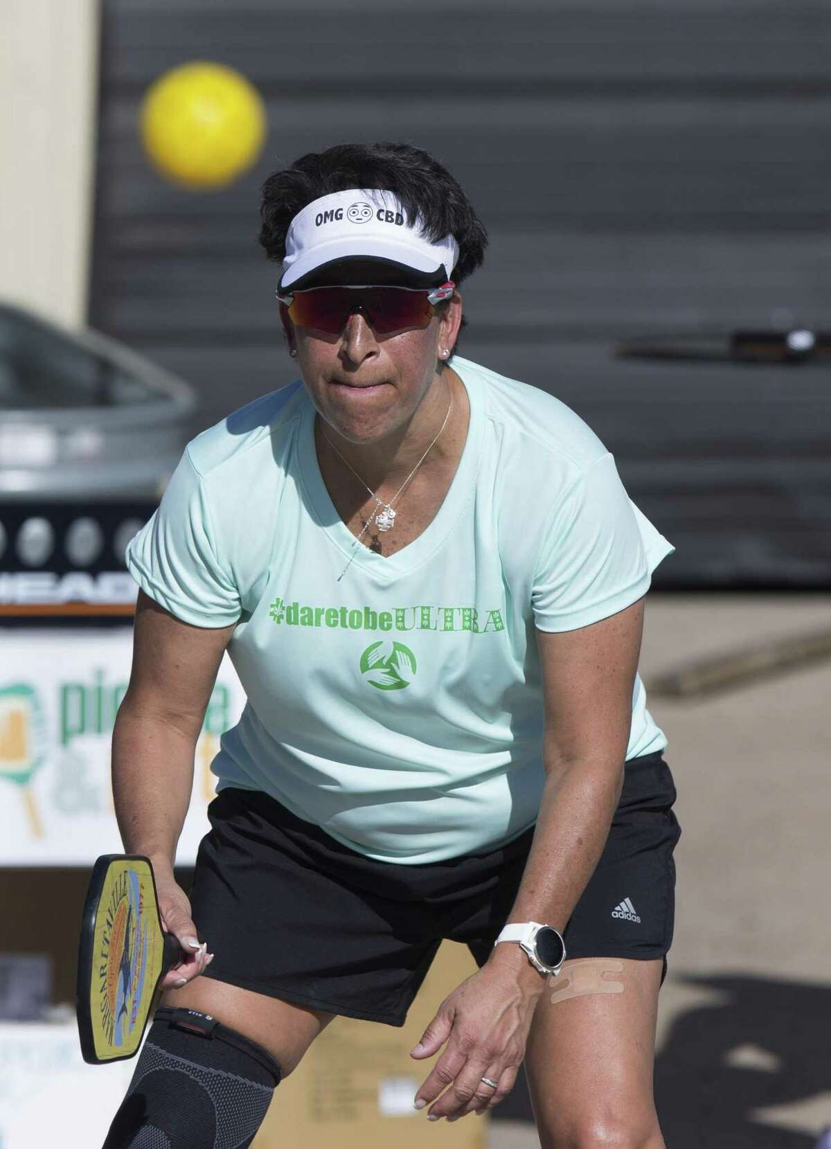 Pickle & Pints member Wendi Myers keeps her eyes on the ball and ready to return the ball to her opponents during a tournament match at No Label Brewing on Saturday, April 20, 2019, in Katy. Pickleball is one of the fastest growing sports in America and Pickle & Pints hosts pickleball tournaments at local breweries.