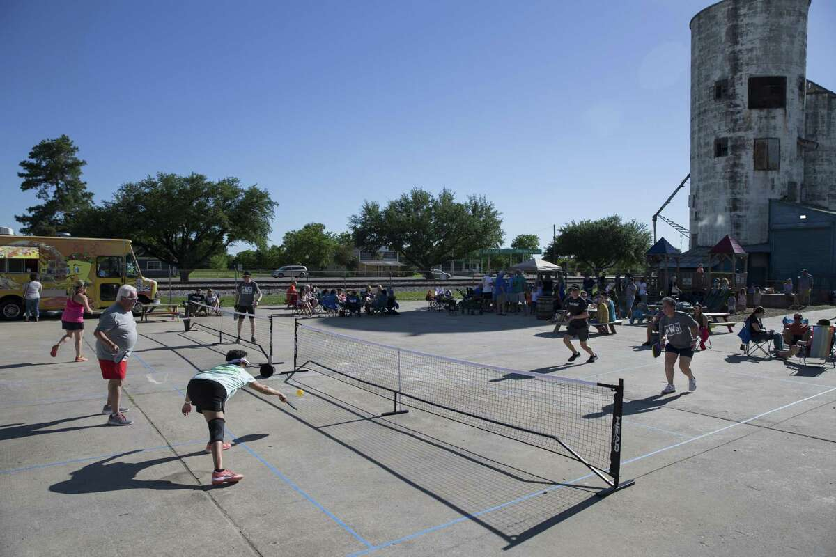 Members of Pickle & Pints, which hosts pickleball tournaments at local breweries, play matches at No Label Brewing on Saturday, April 20, 2019, in Katy. Pickleball is one of the fastest growing sports in America.