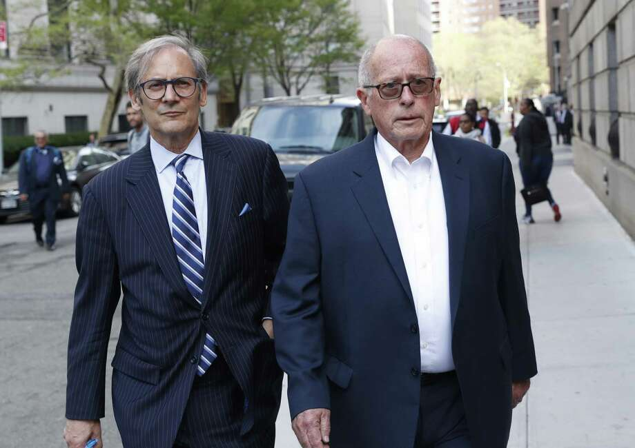 Former Rochester Drug Co-Operative CEO Laurence Doud III, right, leaves US. District Court in Manhattan with his attorney Robert C. Gottlieb, Tuesday, April 23, 2019, in New York. Prosecutors allege Doud ignored red flags to turn his drug distributor into a supplier of last resort as the opioid crisis raged. (AP Photo/Kathy Willens) Photo: Kathy Willens / Associated Press / Copyright 2019 The Associated Press. All rights reserved.