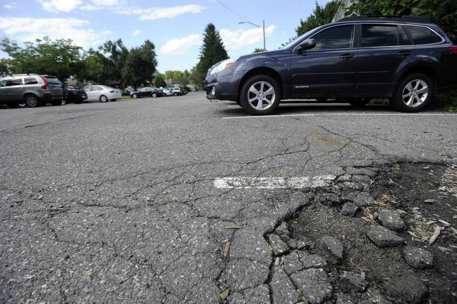 The all-too-common descent of tire into pothole could soon be over for downtown parkers in Ridgefield, Conn. Photo: Carol Kaliff / Carol Kaliff / The News-Times