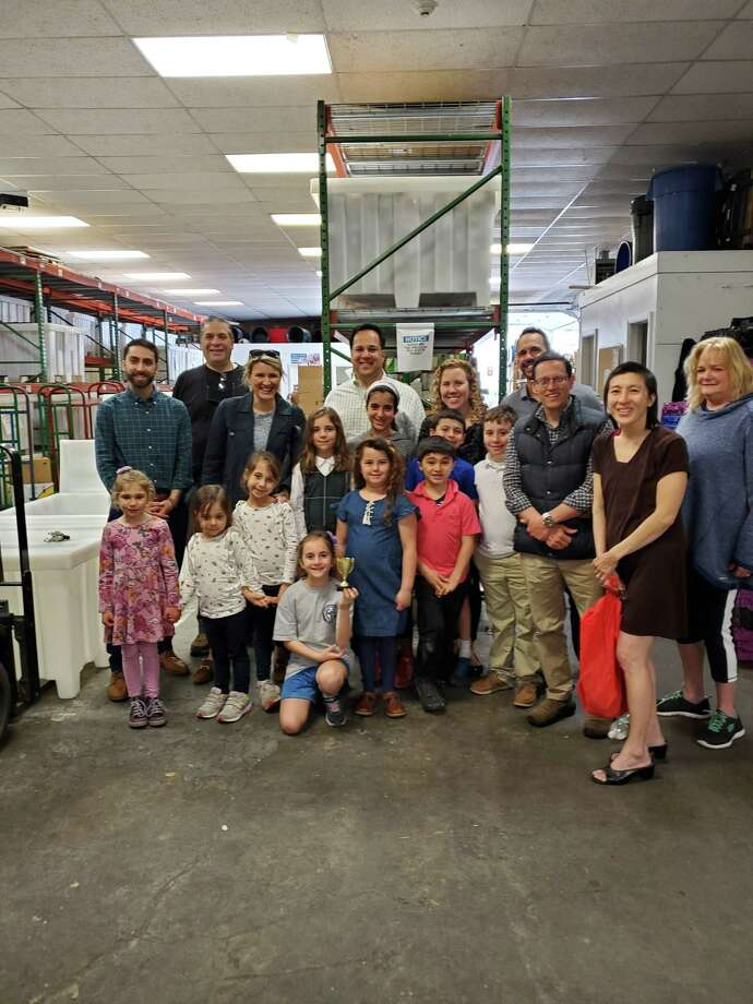 A children's group from the Church of the Archangel in Stamford visited the Lower Fairfield County Food Bank in Stamford on Wednesday, April 24. Photo: Contributed Photo / Contributed Photo / Stamford Advocate Contributed