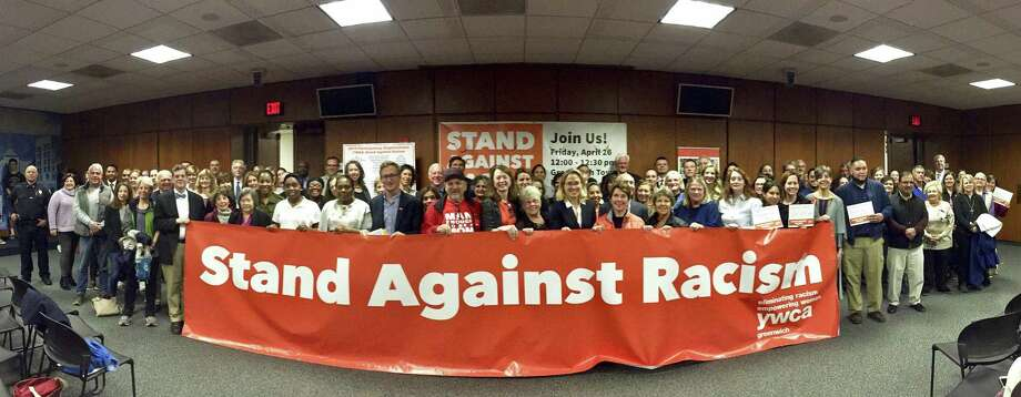 Attendees are photograph with a Stand Against Racism banner at Greenwich Town Hall in Greenwich, Conn. April 25, 2019. This annual town-wide event accentuates the importance of combating bigotry and racism wherever it exists. The free public event is part of a national YWCA initiative in which more than 300,000 people across the United States take part in helping to advance the YWCA's mission to eliminate racism and promote racial justice and civil rights. Photo: Matthew Brown / Hearst Connecticut Media / Stamford Advocate