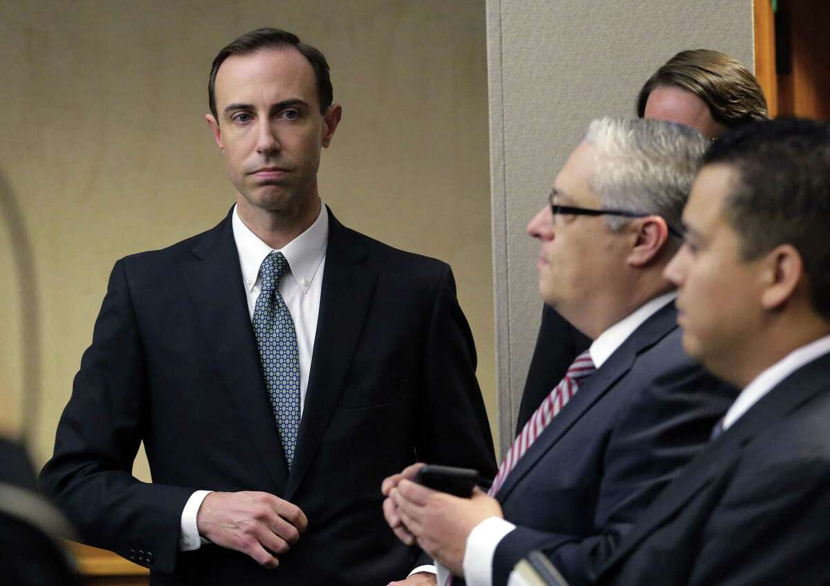 In this Feb. 7, 2019 file photo, Secretary of State David Whitley, left, arrives for his confirmation hearing in Austin, Texas, where he addressed the backlash surrounding Texas' efforts to find noncitizen voters on voter rolls. Whitley's office released an inaccurate list of 95,000 voters flagged as possible non-U.S. citizens. Friday, his office and the plaintiffs in three lawsuits reached a settlement agreement that will be presented to a federal judge in San Antonio on Monday.