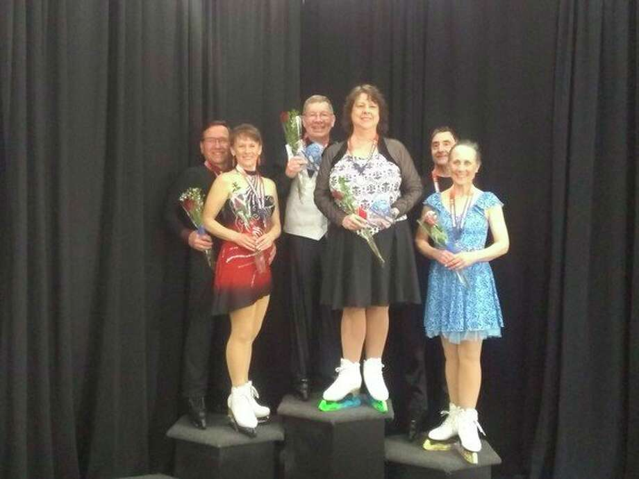 Midland's David Bakkeand Ann Arbor's Marie Sherry stand atop the medal stand after winning the pre-silver Ice Dance event at the U.S. Figure Skating Adult National Championships on April 4 in Salt Lake City, Utah. (Photo provided bySusan Bakke)