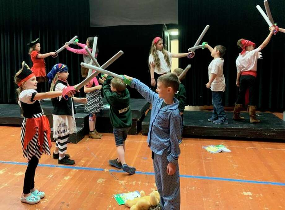 The story of Peter Pan will be brought to life on stage during the Laker Elementary musical, Peter Pan, Jr. More than 50 students are in the production, which is being directed by Samantha Corrion. The musical will take place at 7:30 p.m. May 3 and 4 and at 2 p.m. May 5 at the Laker High School auditorium. Tickets are $5 for adults and $3 for students in grades DK-12. Tickets are available at the door. Pictured are student actors rehearsing choreography for a sword fight. (Submitted Photo)