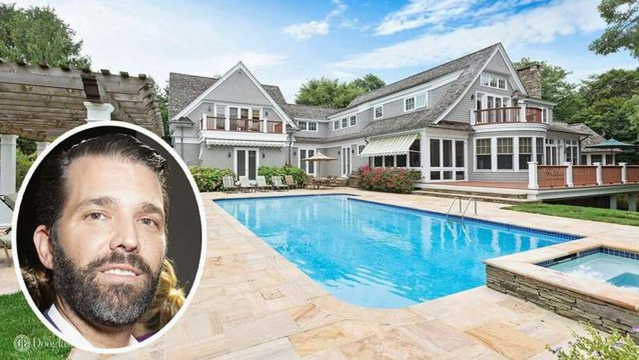 The 9,200-square-foot Bridgehampton, NY home in a gated community sits on 3.9 acres boasting a heated pool with a waterfall and access to a 25-acre kettle pond. Photo: Lev Radin/Pacific Press/LightRocket Via Getty Images; Realtor.com