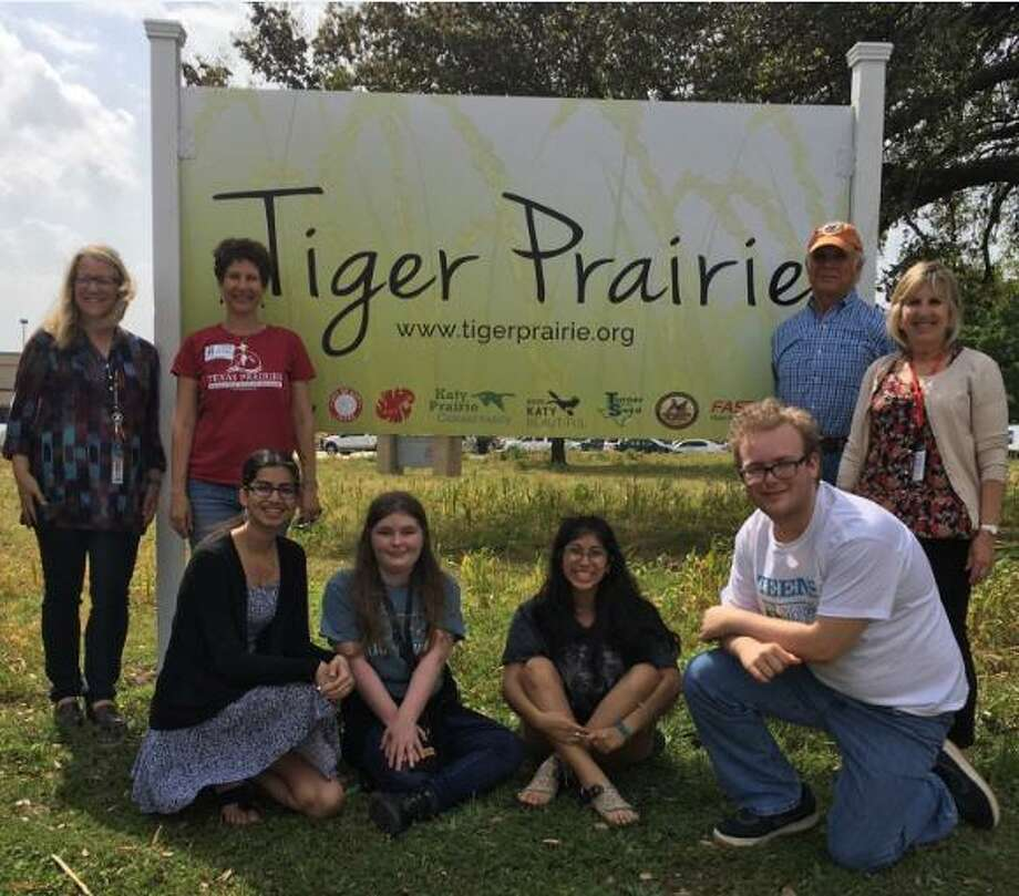 Proud of the new sign for the Tiger Prairie are, from left, standing: Rhonda Burrough, Katy High School environmental teacher; Della Barbato,director of education, Native Prairies Association of Texas; Jim Willis, co-founder/president of Wildlife Habitat Federation; and Susan Barker, Katy High School science instructional coach; in front: students Nandita Deo, Andie Gunn, Brooklyn Garibay and Stone Garza. Photo: Karen Zurawski / Karen Zurawski