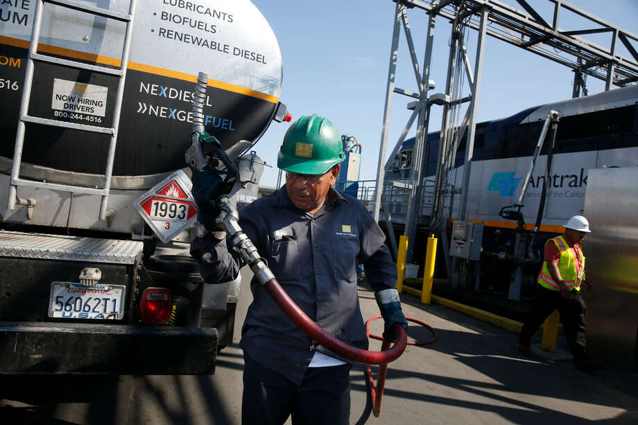FILE PHOTO : Memo Terrones, Golden Gate Petroleum driver, returns a nozzle to the fuel truck after a Capital Corridor locomotive is filled with renewable diesel at the Amtrak Maintenance Facility on Tuesday, September 12, 2017 in Oakland, Calif. Tightening carbon standards in California are expected to boost demand for renewable diesel and other low carbon fuels. San Antonio's Valero Energy is upgraded its renewable diesel facility New Orleans it owns through a subsidiary called Diamond Alternative Energy. Photo: Lea Suzuki / San Francisco Chronicle