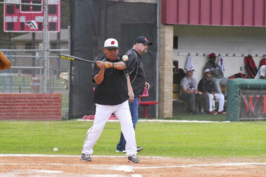Westfield head baseball coach Mario Barrett warms up his players with a hit around. Photo: Tony Gaines /HCN, Photographer