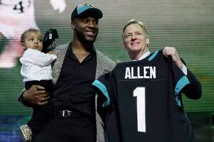 Kentucky linebacker Josh Allen poses with NFL Commissioner Roger Goodell after the Jacksonville Jaguars selected Allen in the first round at the NFL football draft, Thursday, April 25, 2019, in Nashville, Tenn.(AP Photo/Mark Humphrey)