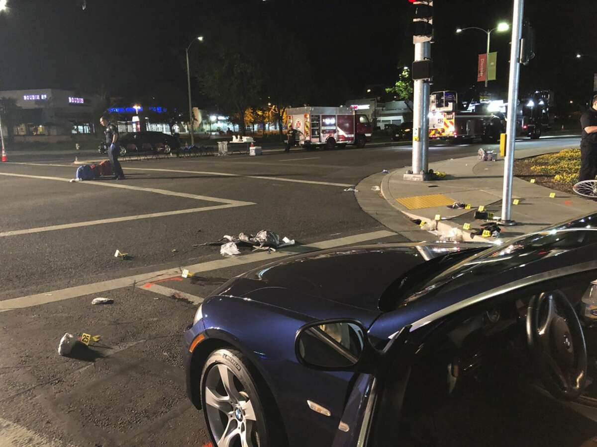 In this photo taken Tuesday, April 23, 2019 provided by Don Draper, an officer works the scene of a car crash that injured several people in Sunnyvale, Calif. A former Army sharpshooter with a history of post-traumatic stress disorder plowed his car at high speed into a group of pedestrians in the Silicon Valley suburb, and then told authorities that he intentionally hit them, police said. (Don Draper via AP)