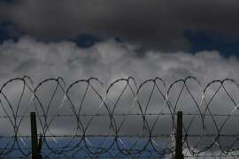 Concertina wire sits at the top of the dual fences at the Central Valley Modified Modified Community Correctional Facility in McFarland, Calif., on Thursday, March 28, 2019.  California Gov. Gavin Newsom is trying to figure out how to empty privately run prisons of California inmates, who would be sent to state-run lockups like this one run by GEO Group.