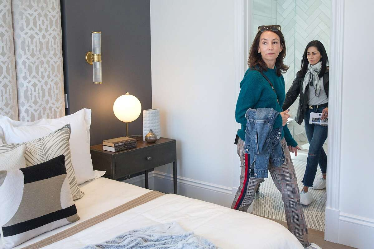 """Maria Borda, left, and Maria Gutman visit a house that was featured on the 1980 t.v. show """"Full House"""" and which is officially hitting the market next week. On Friday, April 26, 2019. San Francisco, Calif."""