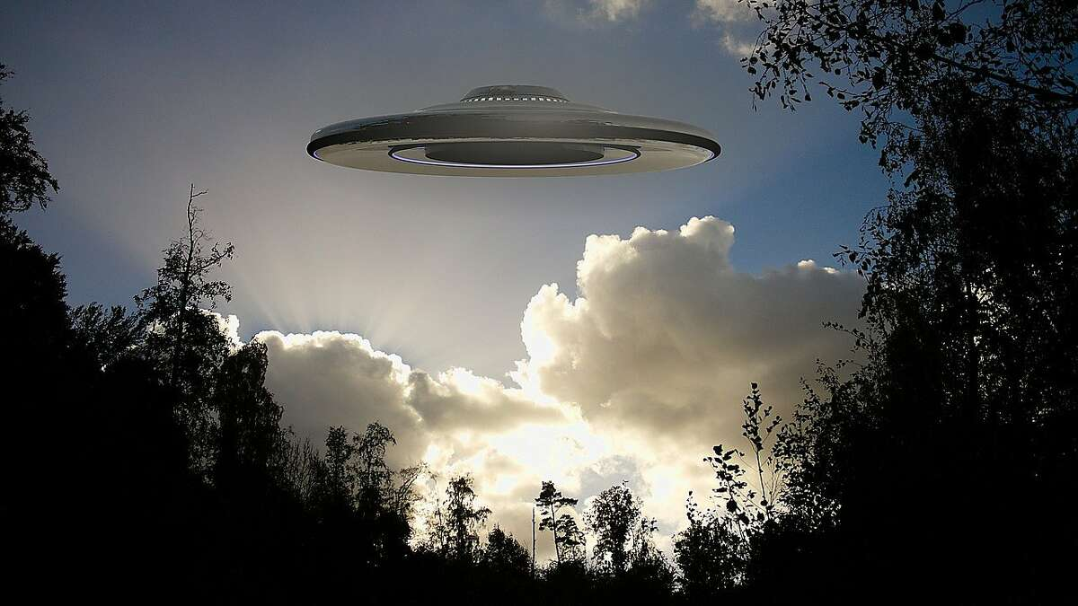 """Hamden, June 23: """"Steady flashing object with three lights hovered in sky. """"Saw three bright lights in a row - the actual shape looked like a disk Several helicopters monitored it- one was still, others did circle around it, The lights seemed to change formation, but remained steady on - Husband is into planes and helicopters and confirmed it was not either, nor was it a drone What got our attention was the behavior of the helicopters that seemed to monitor it."""""""