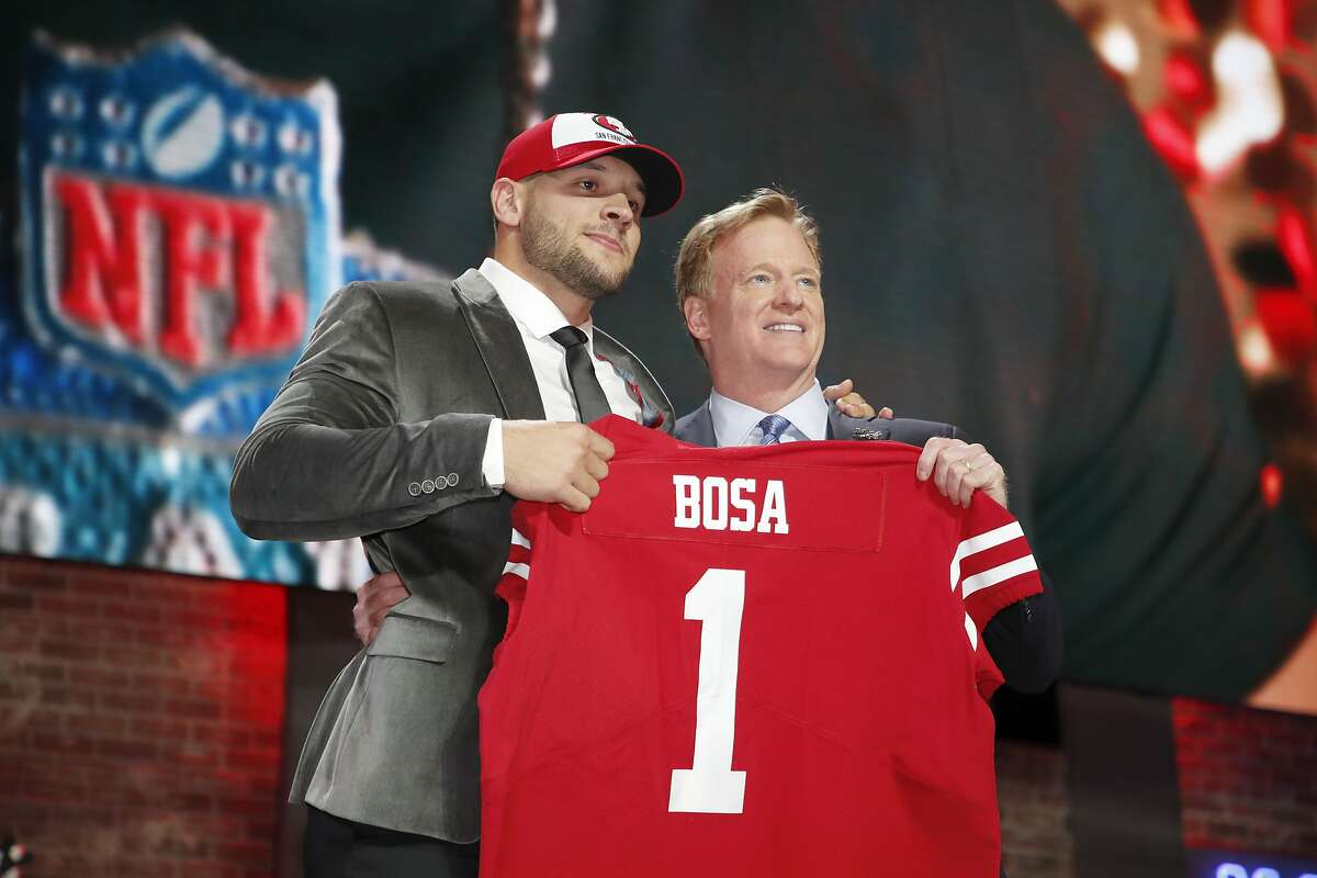 Ohio State defensive end Nick Bosa poses with NFL Commissioner Roger Goodell after the San Francisco 49ers selected Bosa in the first round at the NFL football draft, Thursday, April 25, 2019, in Nashville, Tenn. (Jeff Haynes/AP Images for Panini)