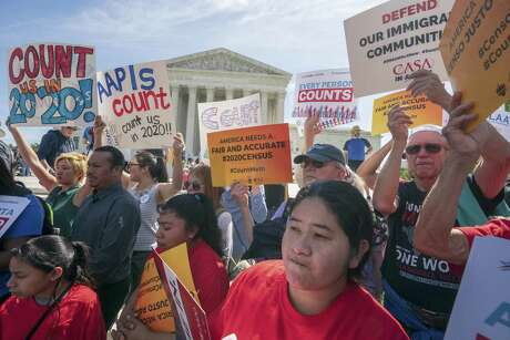 Immigration activists rally outside the Supreme Court as the justices hear arguments over the Trump administration's plan to ask about citizenship on the 2020 census. Critics say the citizenship question on the census will inhibit responses from immigrant-heavy communities that are worried the information will be used to target them for possible deportation.