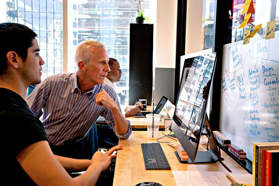 Derek  Gordon, Chief Operating Officer of Calbright Community College, works with Moses Maynez at WeWork Wednesday, April 17, 2019, in Oakland, Calif. Photo: Paul Kuroda / Special To The Chronicle