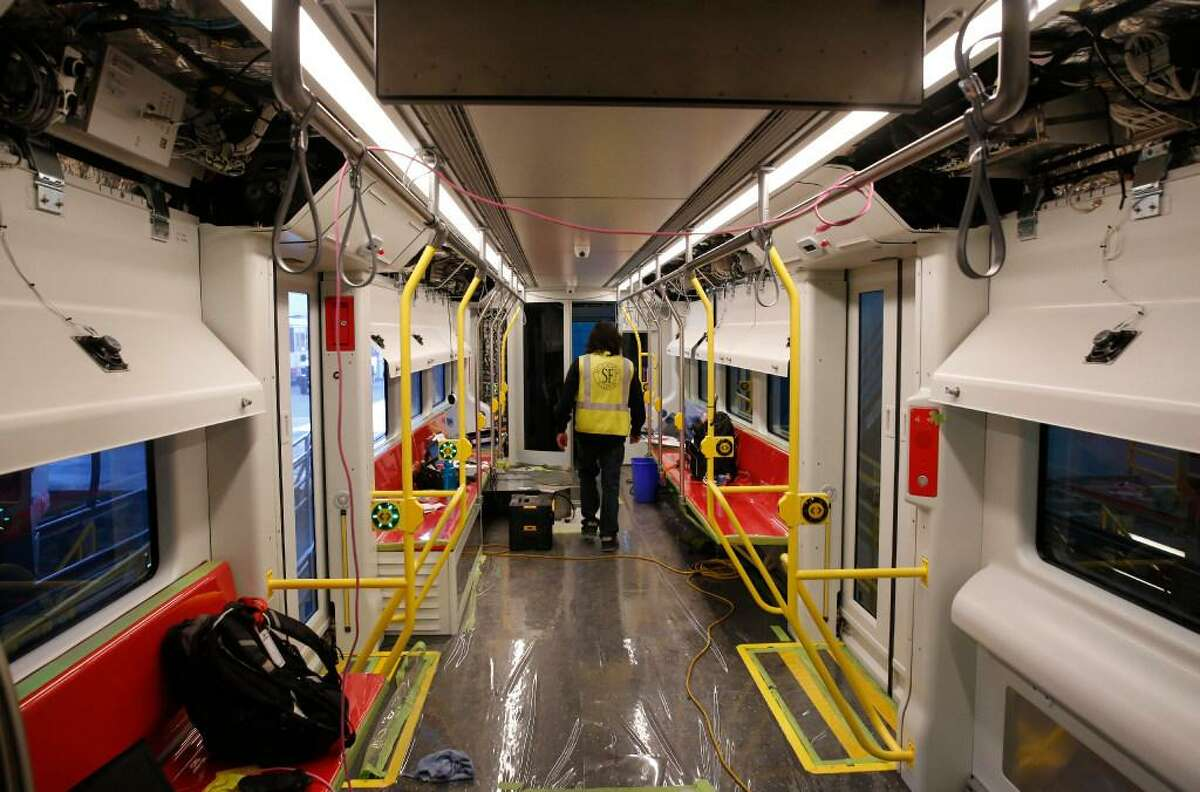 Siemens Technician Jonathan Binaday walks through a new MUNI train as he and other Siemens workers test its systems at MUNI Metro East Maintenance Facility July 20, 2017 in San Francisco, Calif.