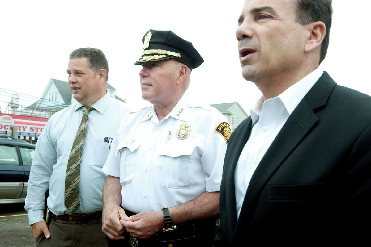 From left, Police Union President Chuck Paris, Police Chief Armando