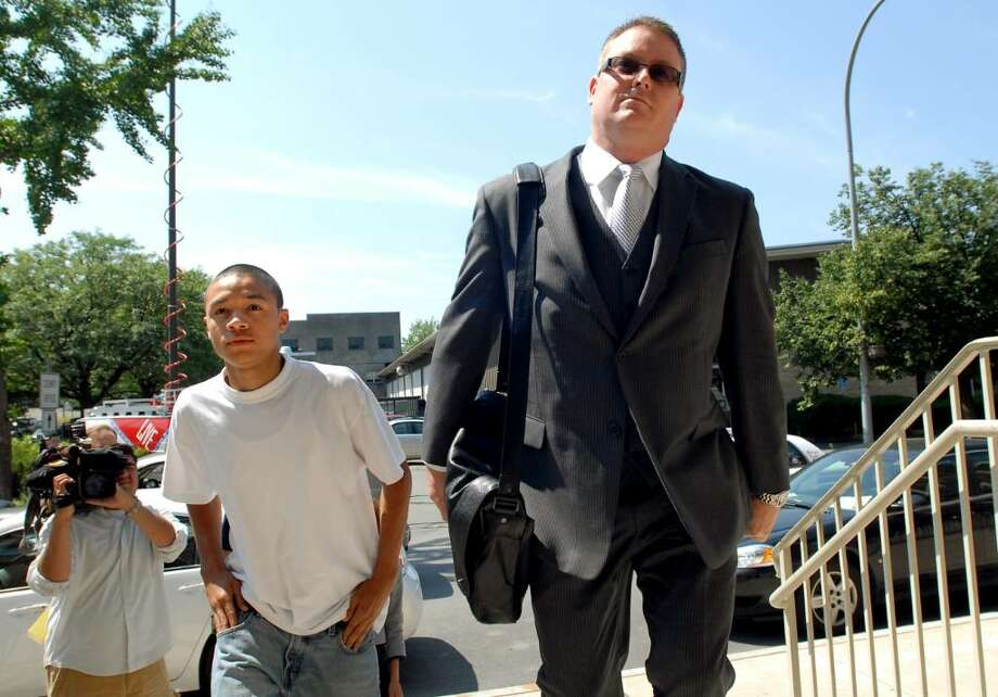 Kemo Santana, 18, and his attorney, Joe Ahearn, head into the Troy Police Department on Tuesday. (Cindy Schultz / Times Union). Photo: CINDY SCHULTZ / 00009641A