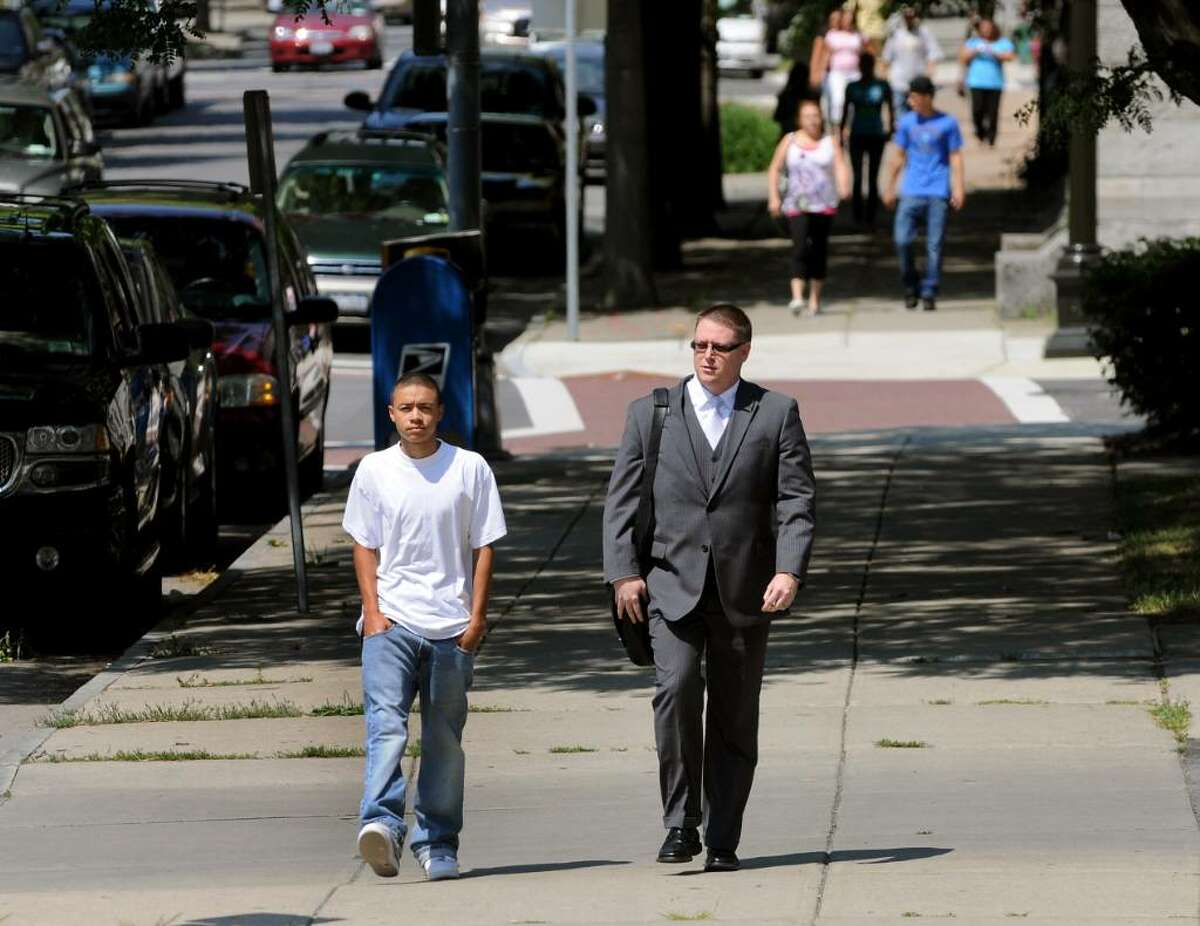 Kemo Santana, 18, and his attorney, Joe Ahearn, head to the Troy Police Department on Tuesday. (Cindy Schultz / Times Union)