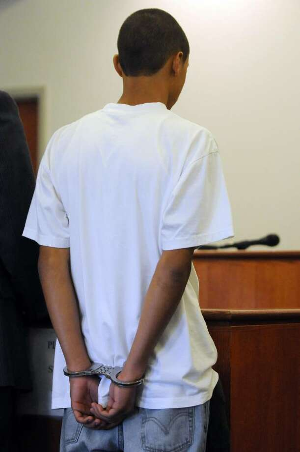 Kemo Santana, 18, stands before the judge Tuesday during his arraignment  in Troy City Court. (Cindy Schultz / Times Union) Photo: CINDY SCHULTZ