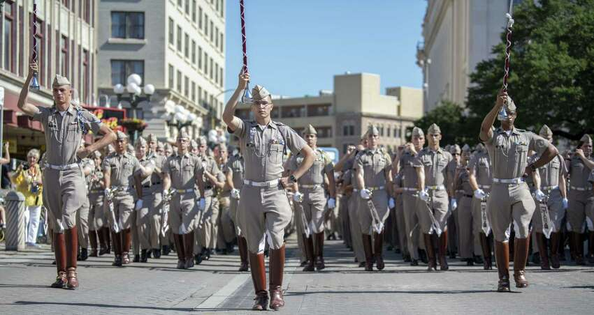 Battle of Flowers 2019: Members of the Texas A&M Marching band kick off the Battle of Flowers Parade.