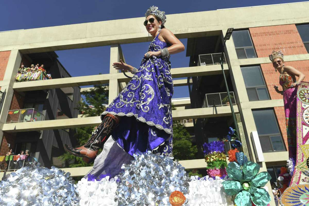 Serena Caroline Koontz, Duchess of a New Nation, shows her shoe during the Battle of Flowers Parade along Broadway on Friday, April 26, 2019.