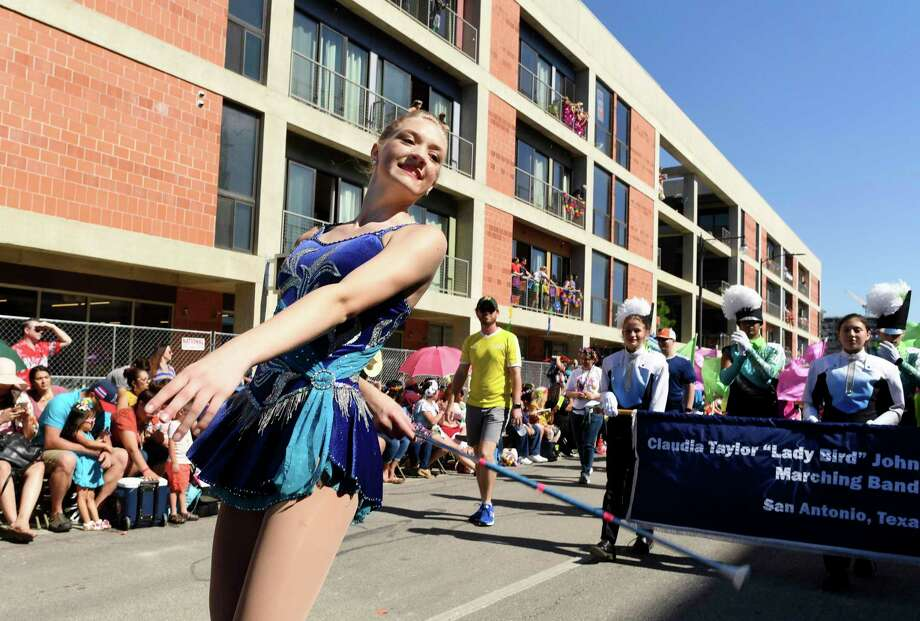Majorette Bethany Williams marches with the Johnson High School band during the 2019 Battle of Flowers Parade. Each year, nine San Antonio high schools are invited to take part in the parade. Photo: Billy Calzada /Staff Photographer / San Antonio Express-News