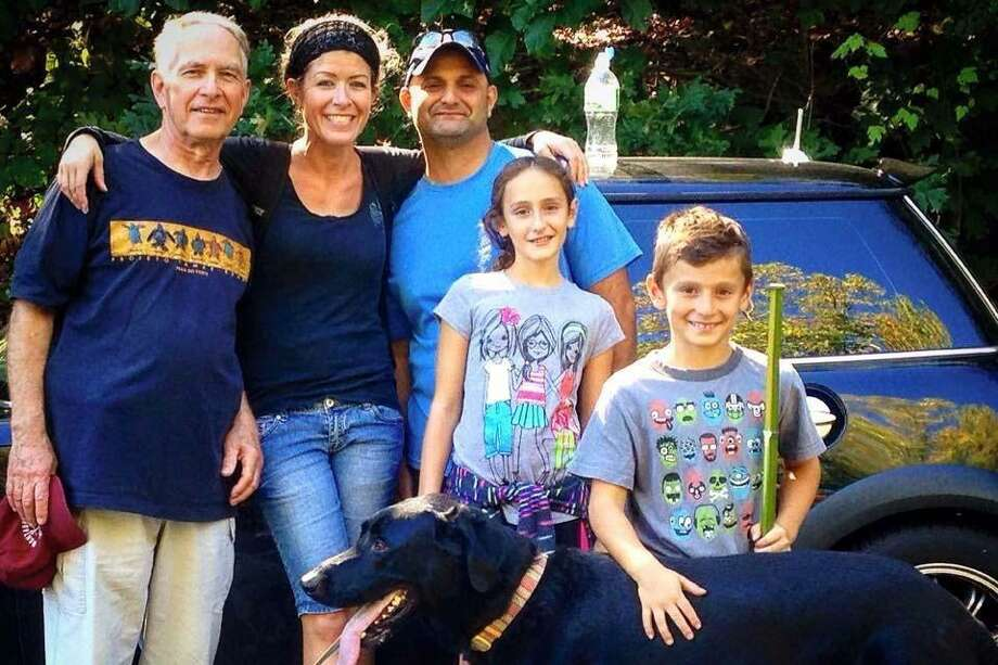 Turk Aksoy poses with his family members for a photo, which was posted on the GoFundMe page created to help raise money for the Aksoys. Photo: Contributed Photo / GoFundMe Page / Connecticut Post Contributed