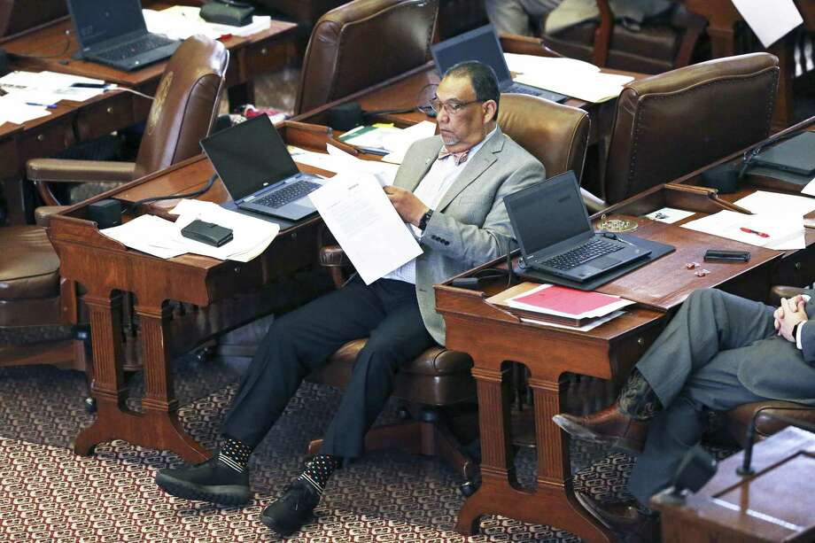 Rep.  Joe Deshotel, D-Beaumont, stretches out into the aisle as he reviews printed material as the Texas House of Representatives takes up the budget bill on March 27, 2019. Photo: Tom Reel, Staff / Staff Photographer / 2019 SAN ANTONIO EXPRESS-NEWS