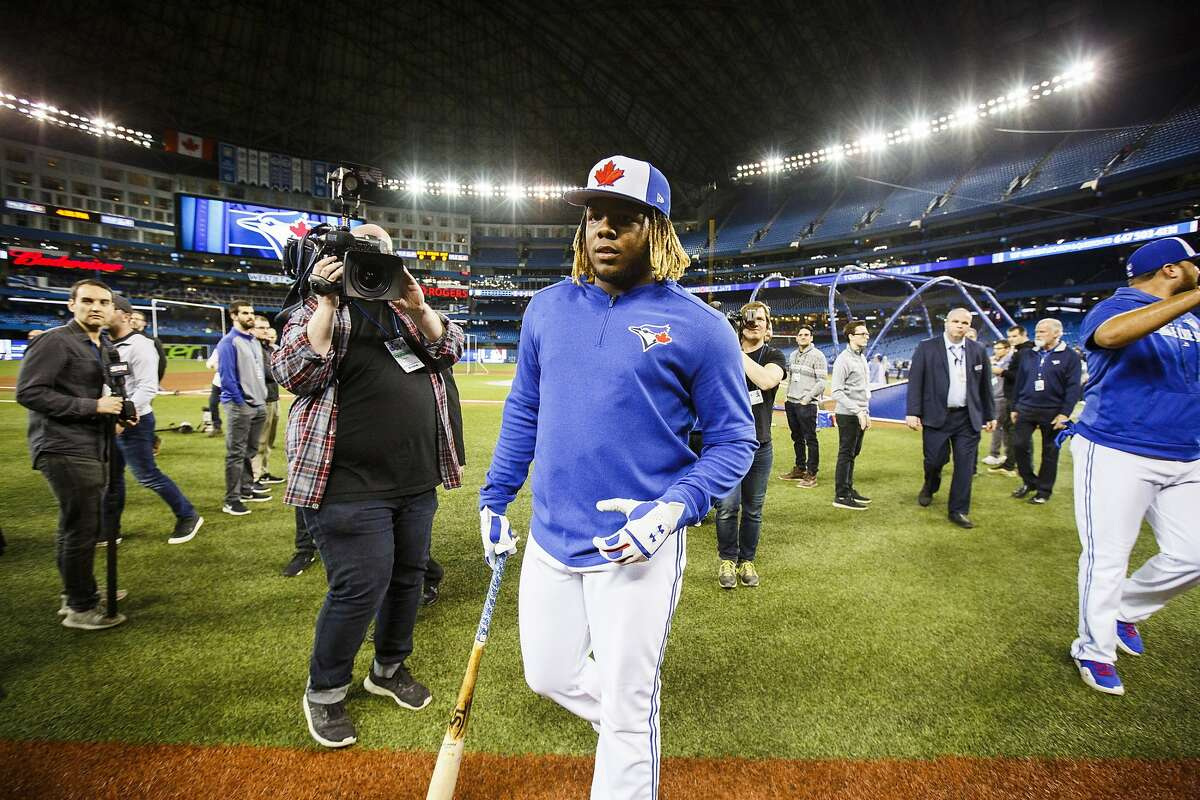 Toronto Blue Jays rookie Vladimir Guerrero Jr. walks off the field after batting practice before his major league debut against the Oakland Athletics in a baseball game in Toronto, Friday April 26, 2019. (Mark Blinch/The Canadian Press via AP)